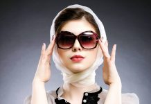 Woman wearing sunglasses and head scarf, pollution