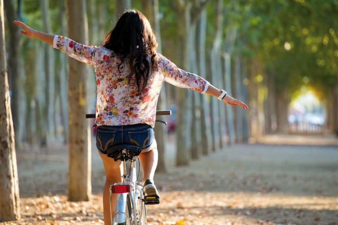A happy woman riding bicycle