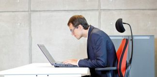 Man sitting in an ergonomic chair and working