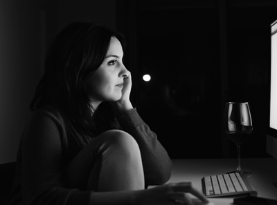 Woman working on computer at night