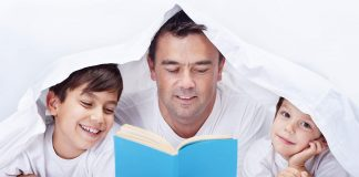Father reading and telling story to sons