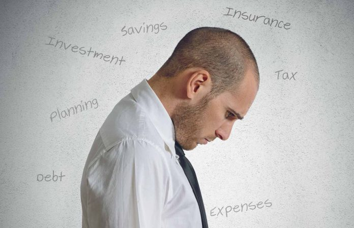 Man with head down thinking about finances