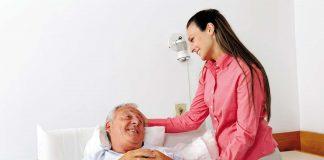 Woman taking care of an elderly man