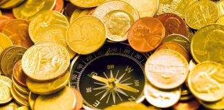 Directional magnetic compass in money