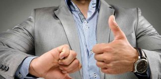 Man showing thumbs up and thumbs down; body language