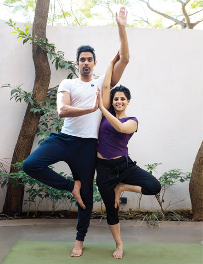 Couple demonstrating the Twin Trees yoga pose