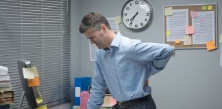 Tired business with lower back pain and sciatica