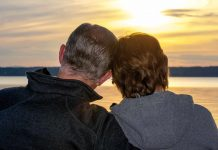 Senior couple watching sunset / life after retirement