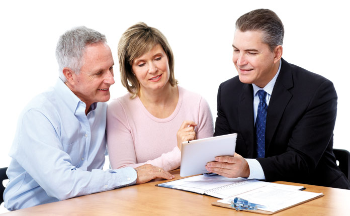 Man explaining retirement financial plan to elderly couples