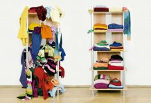 a cluttered rack of clothes next to a tidy one