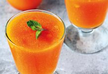 orange drink in glass with mint leaf