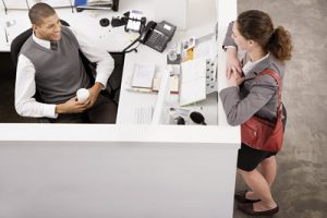 Woman talking to her male colleague in office