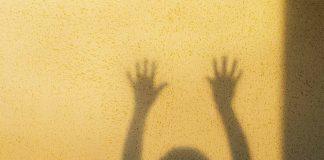 Little girl hands shadow / fear concept