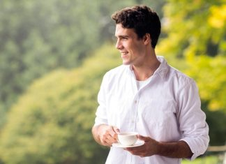 Man smiling with tea