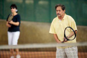Old man playing tennis