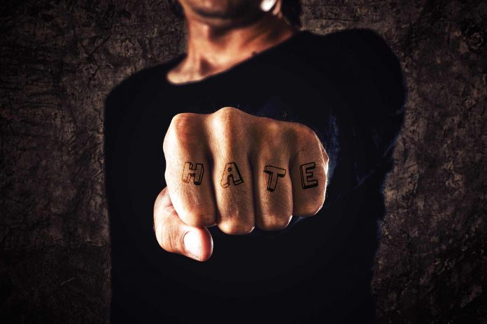 Hate written on punch