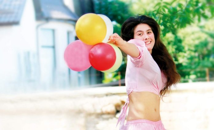 Happy woman with baloon; freedom
