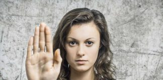 lady showing her hand to indicate stop