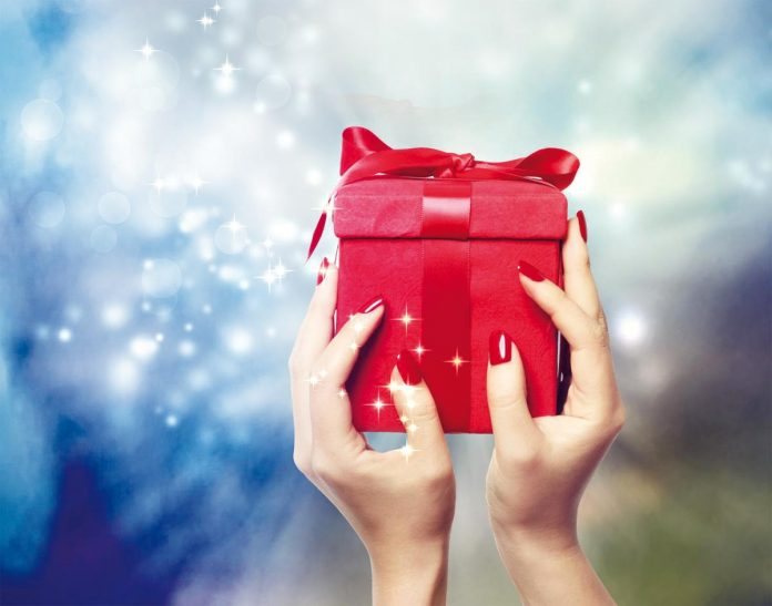 Red gift box in woman's hands