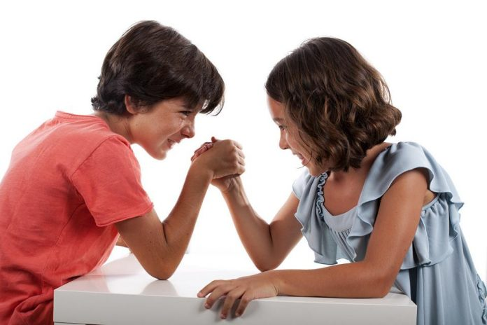 young girls arm wrestling / sibling rivaly