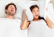 Couple in bed, man snoring and wife cannot sleep
