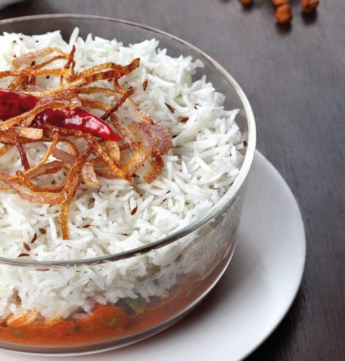 Biryani in casserole, fried onions, chana