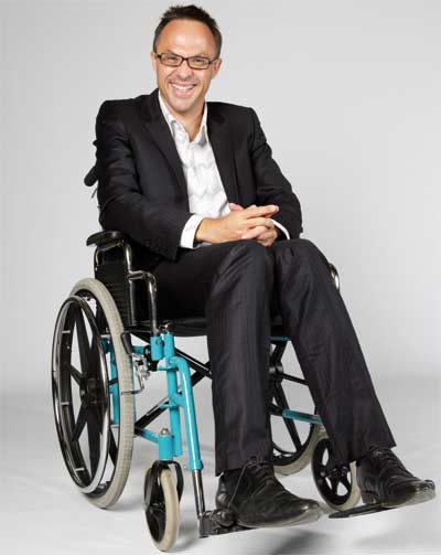 Man on a wheel-chair with a great smile on his face