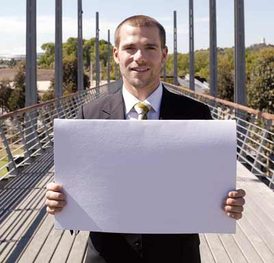 Man holding a blank white paper