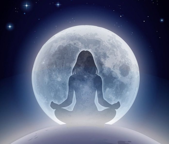 Portrait of woman meditating / concept of inner balance