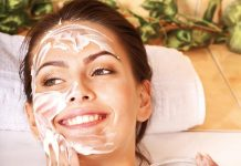 Woman applying cream on her face / skin care concept