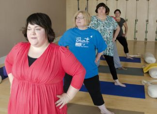 Anna Jelly teaching a class of curvy yoga