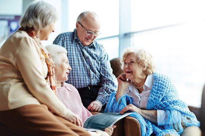 Four elders sharing a happy conversation