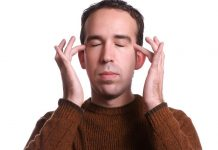 Closeup view of a man using fasterEFT tapping to help relieve various physical and emotional ailments