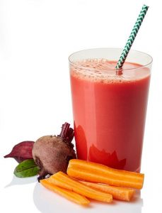 Glass of fresh carrot - beetroot - tomato juice