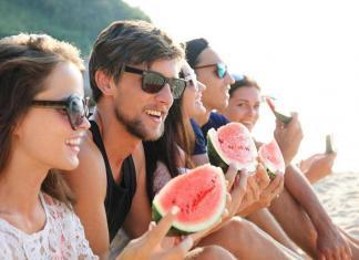Friends eating watermelon slices outdoor / influence