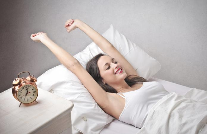 Woman waking up after a sound sleep