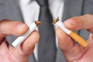 The nicotine in your cigarette inhibits the onset of sleep