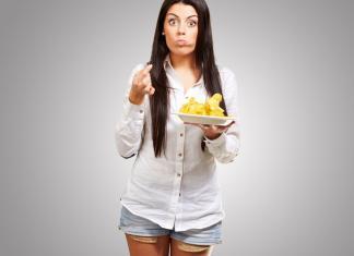 young woman binge eating potato chips