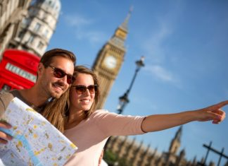 Travelling couple exploring city with map