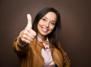 beautiful smiling woman showing a thumbs up