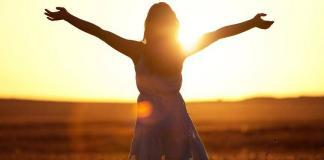 Free woman with open arms in an open field / freedom from PCOD