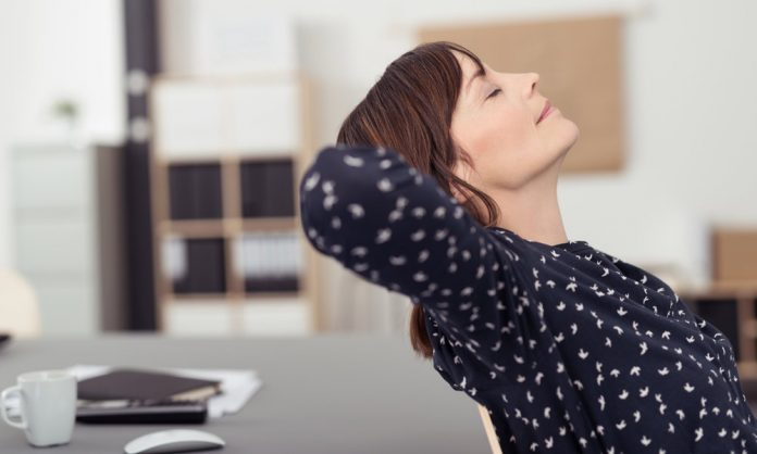 Woman sitting with eyes closed, visualisation