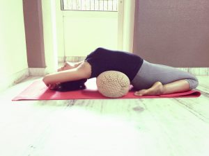 Supta Virasana with bolster