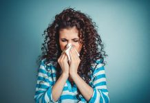 woman sneezing, flu