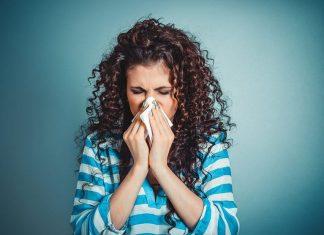 woman sneezing, flu
