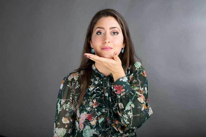 woman doing face yoga