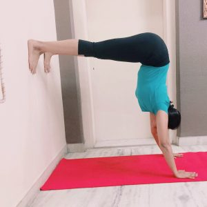 Half handstand using wall