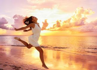 happy woman jumping on the beach, carefree