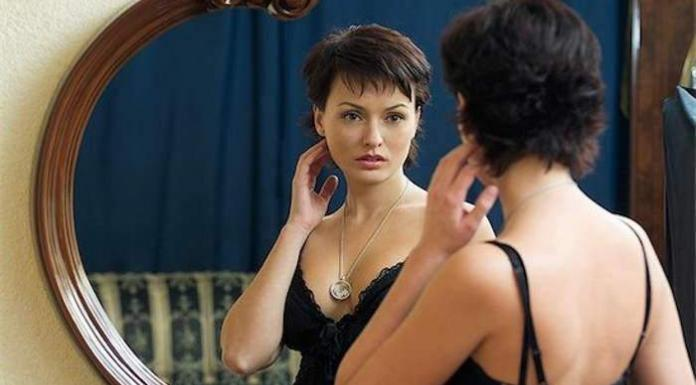 woman looking in mirror, bod images issue