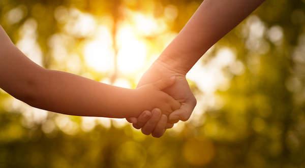 parent holding child's hand